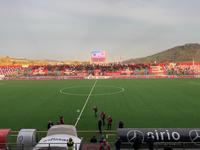 foto del campo di calcio al Bonolis, con banner luminoso a bordocampo con la scritta